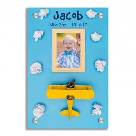 Wooden frame with toy plane and could for travel concept