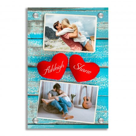 Blank photo frame album and red heart  on vintage blue wood back