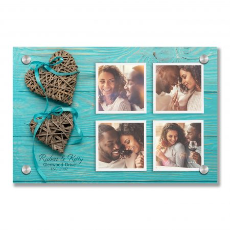 Decorative wicker hearts of gray color with a blue ribbon on a w