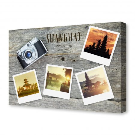 Old analog camera with blank photo frames, on wooden surface