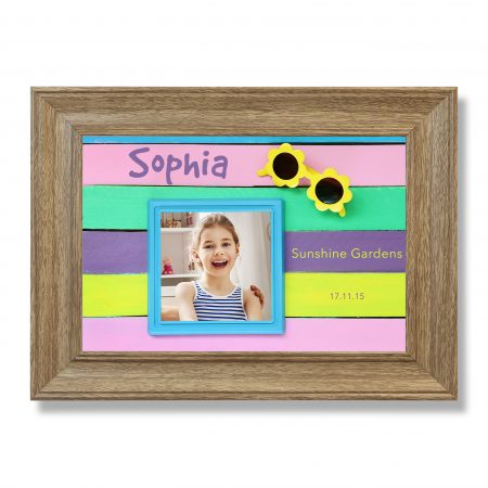 photo frame and sunglasses on colorful wooden background.